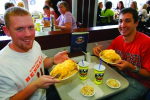 Happy diners sample the cinnamon-spiced chili served on spaghetti at Cincinnati's Skyline Chili restaurant. / Photo courtesy of Cincinnati USA Regional Tourism Network, ©JeffreyGreenberg@aol.com