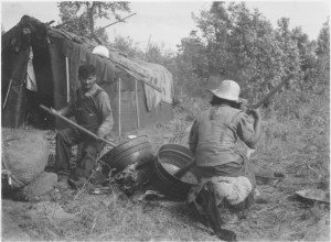 This 1937 photograph shows Paul Buffalo and his wife parching wild rice in their camp in Minnesota/ National Archives and Records Administration